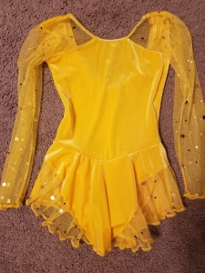 Yellow dress with bling. Size child small. $15.